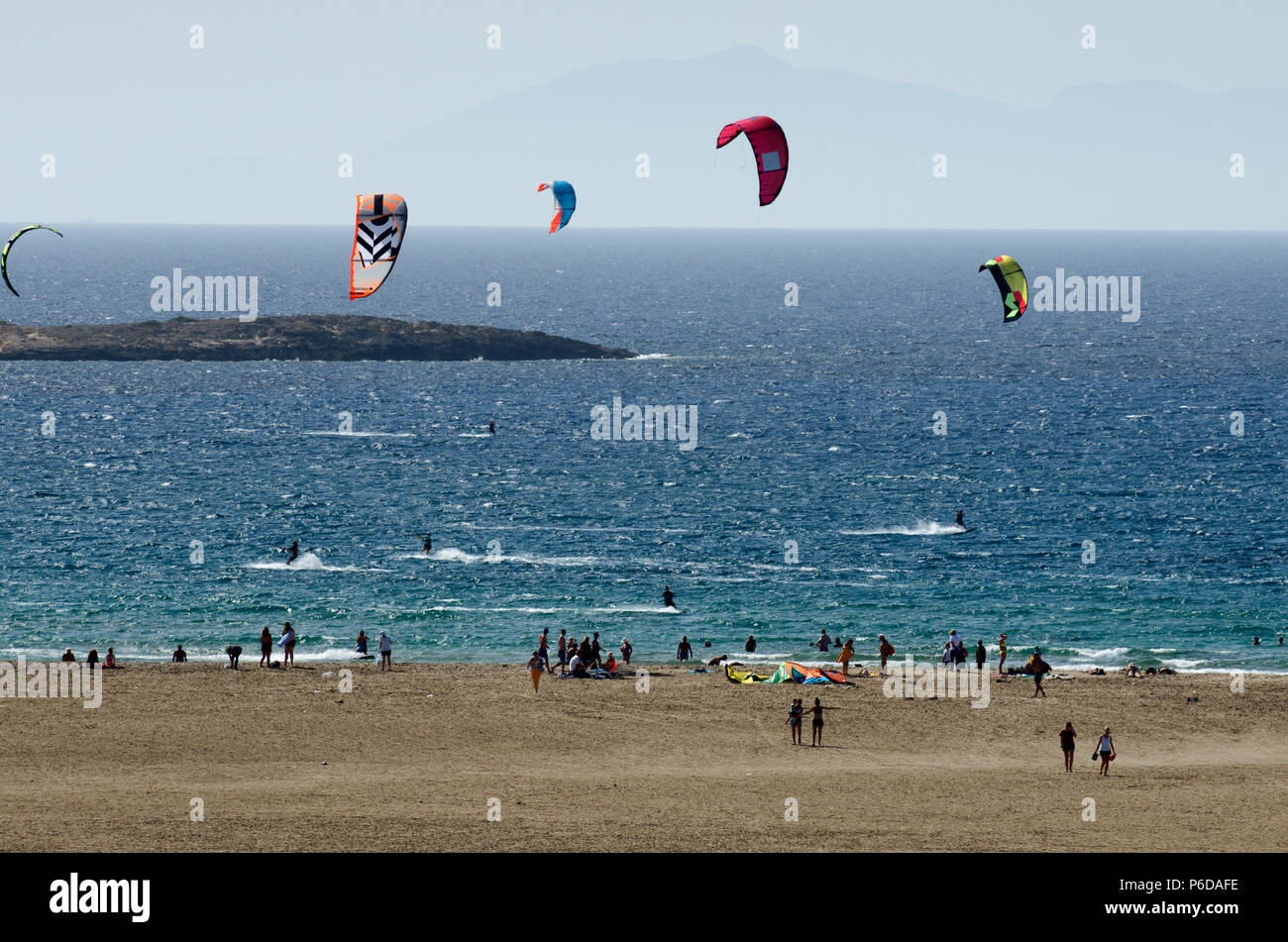 Sandy beach and the kitesurfers on the waves of the Aegean sea at Prasonisi (Greece) - Stock Image