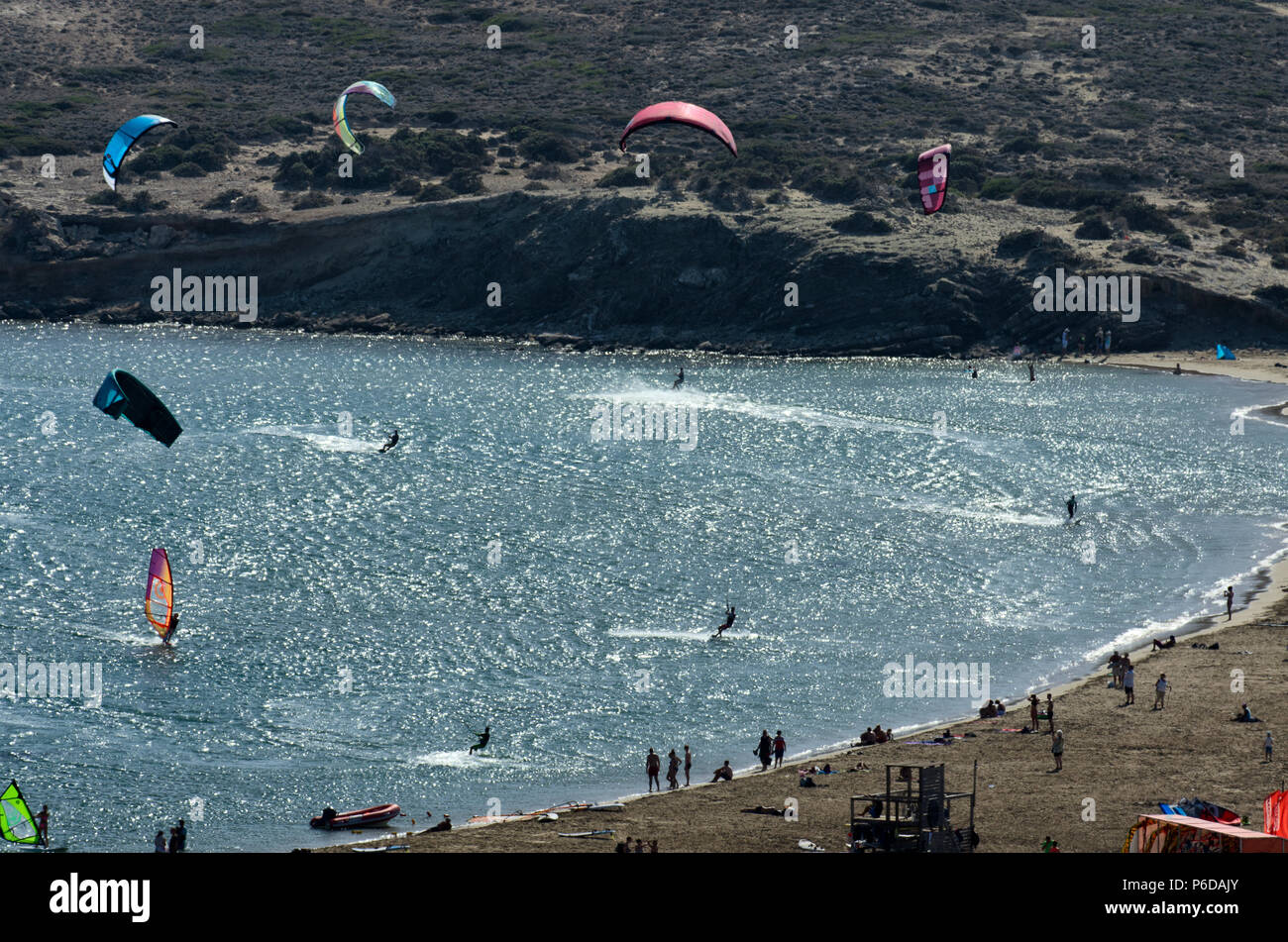Kitesurfers on the waves of the Mediterranean sea at Cape Prasonisi (Greece) - Stock Image