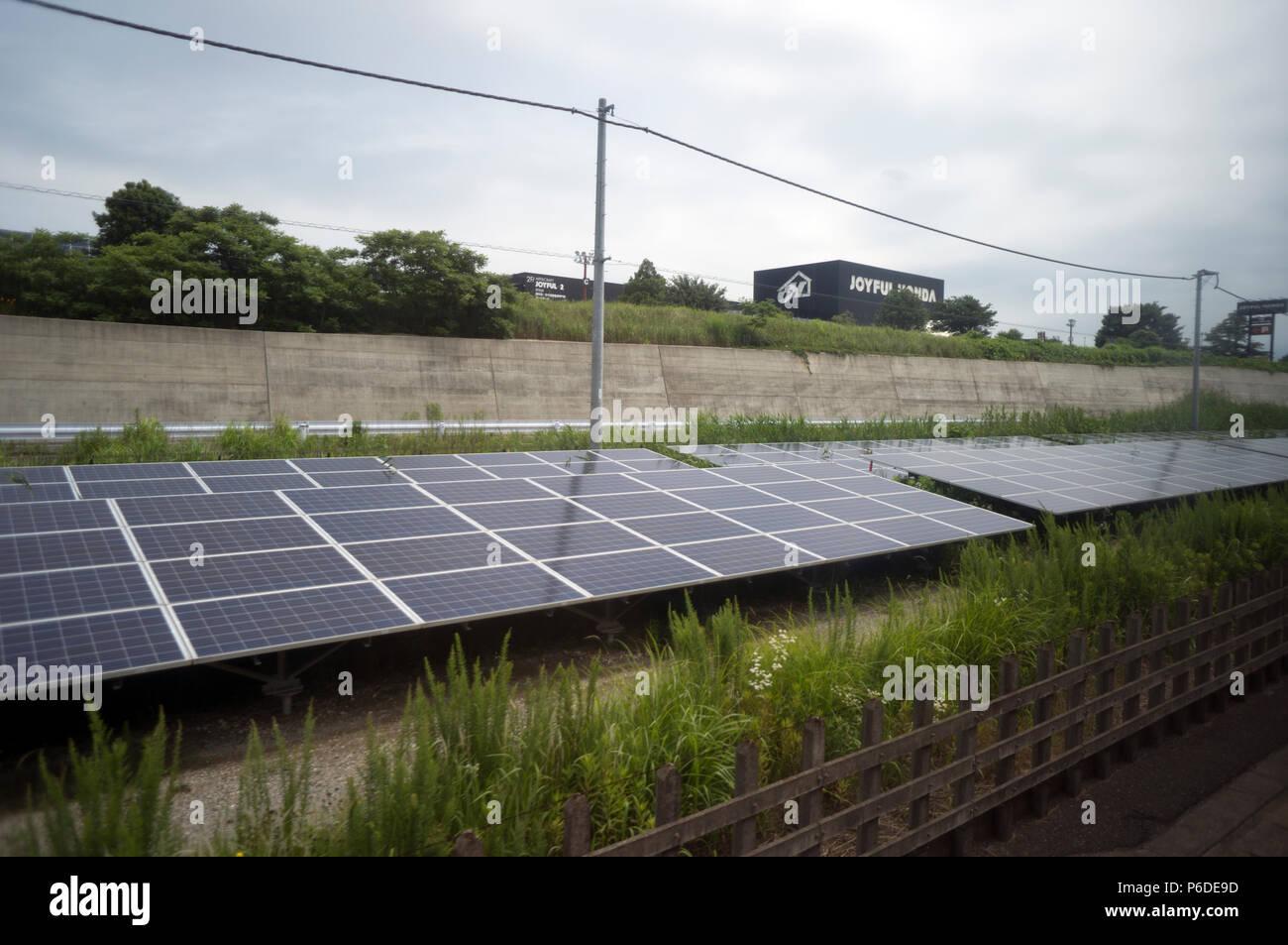 kilometres of Solar panels along the railway to Narita airport, Tokyo Japan - Stock Image
