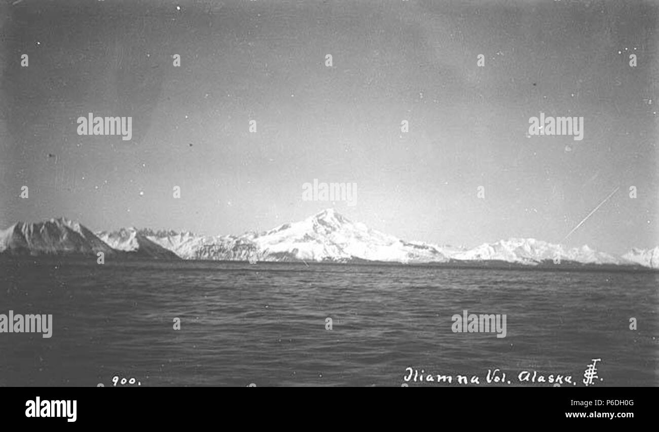 . English: Iliamna Volcano, ca. 1912 . English: Caption on image: Iliamna Vol. Alaska PH Coll 247.268 Iliamna Volcano sits by the side of Cook Inlet in southern Alaska right across from the town of Homer, quietly fuming. Its rugged cone is mostly covered with snow and ice and is deeply dissected by glaciers, a sign that erosion is wearing it down faster than eruptions are building it. Some fumaroles high on Iliamna's flanks emit occasional vapors, but its last proper eruption appears to have happened 300 years ago. Still, a few deep rumblings have been monitored in the hot spaces beneath, and  - Stock Image