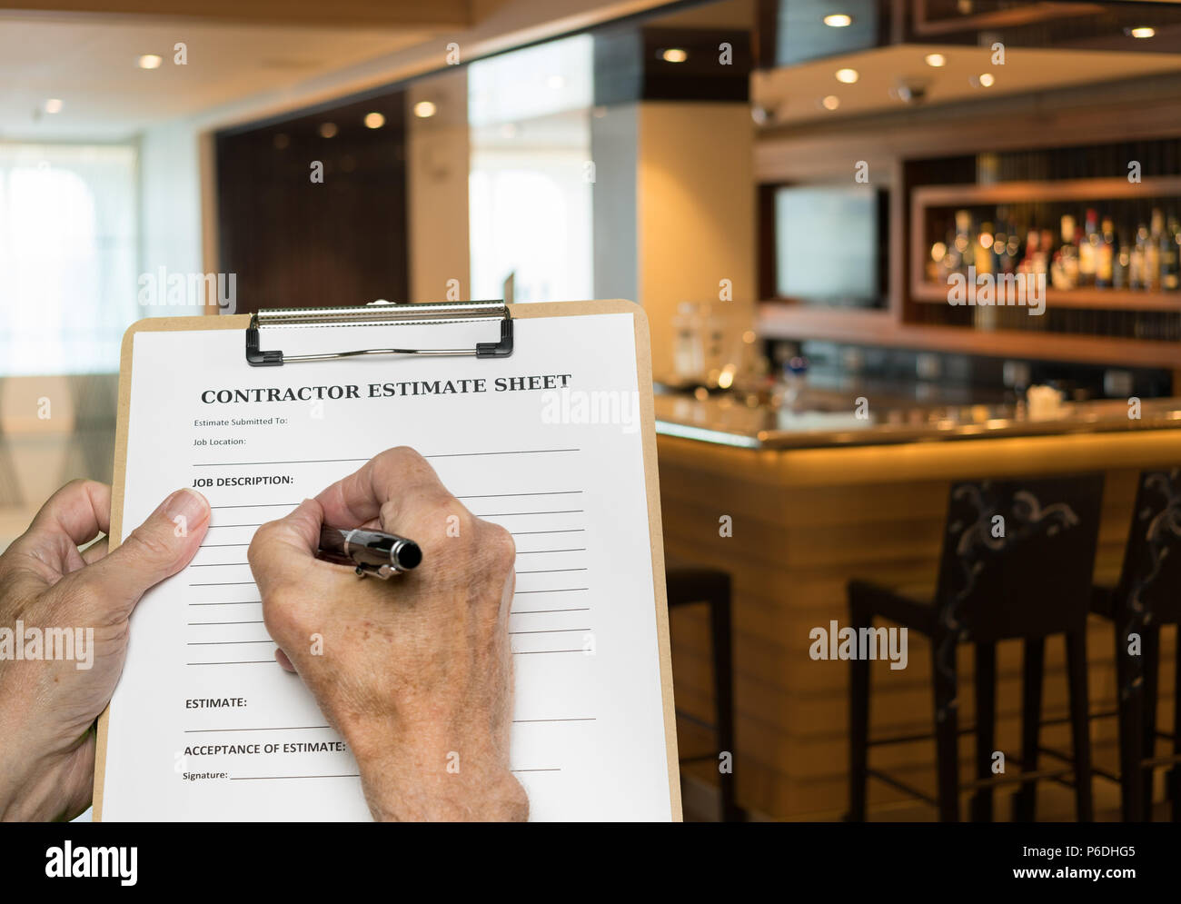 Contractor filling out estimate for refitting modern bar - Stock Image