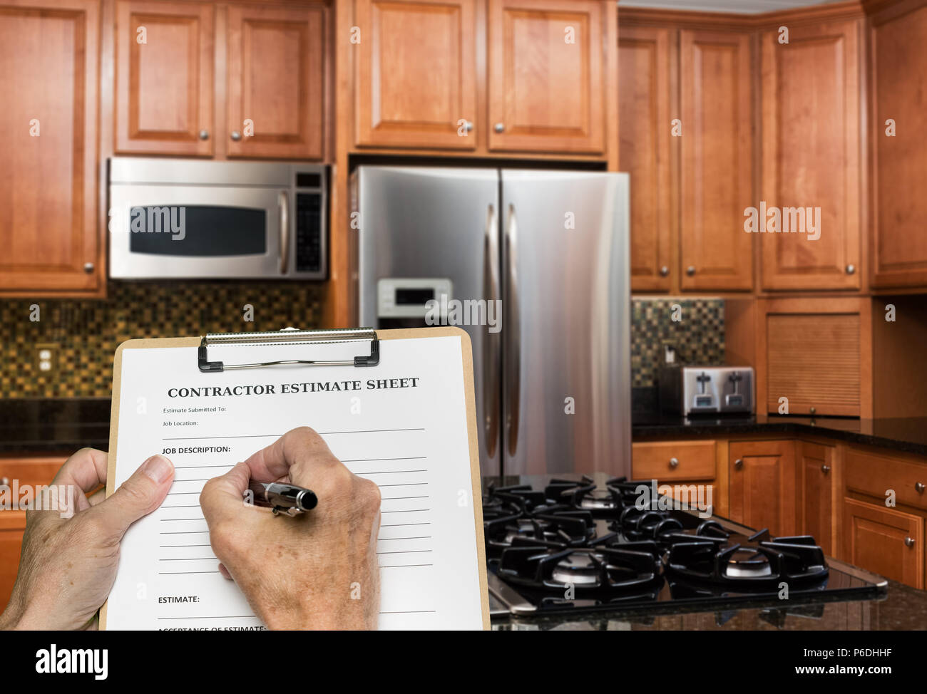 Contractor fills out estimate for modern kitchen - Stock Image