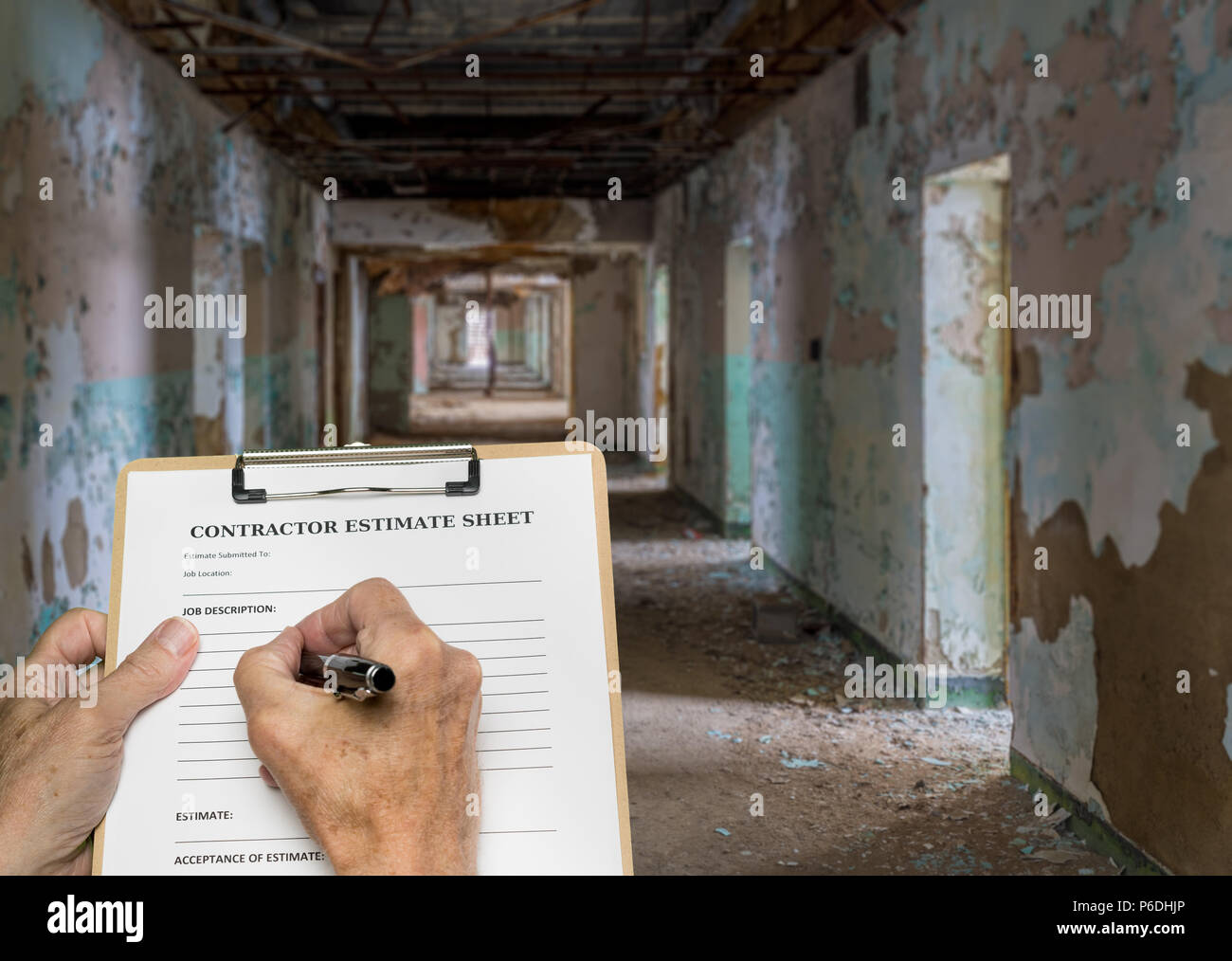 Contractor filling out estimate for abandoned office or hotel - Stock Image
