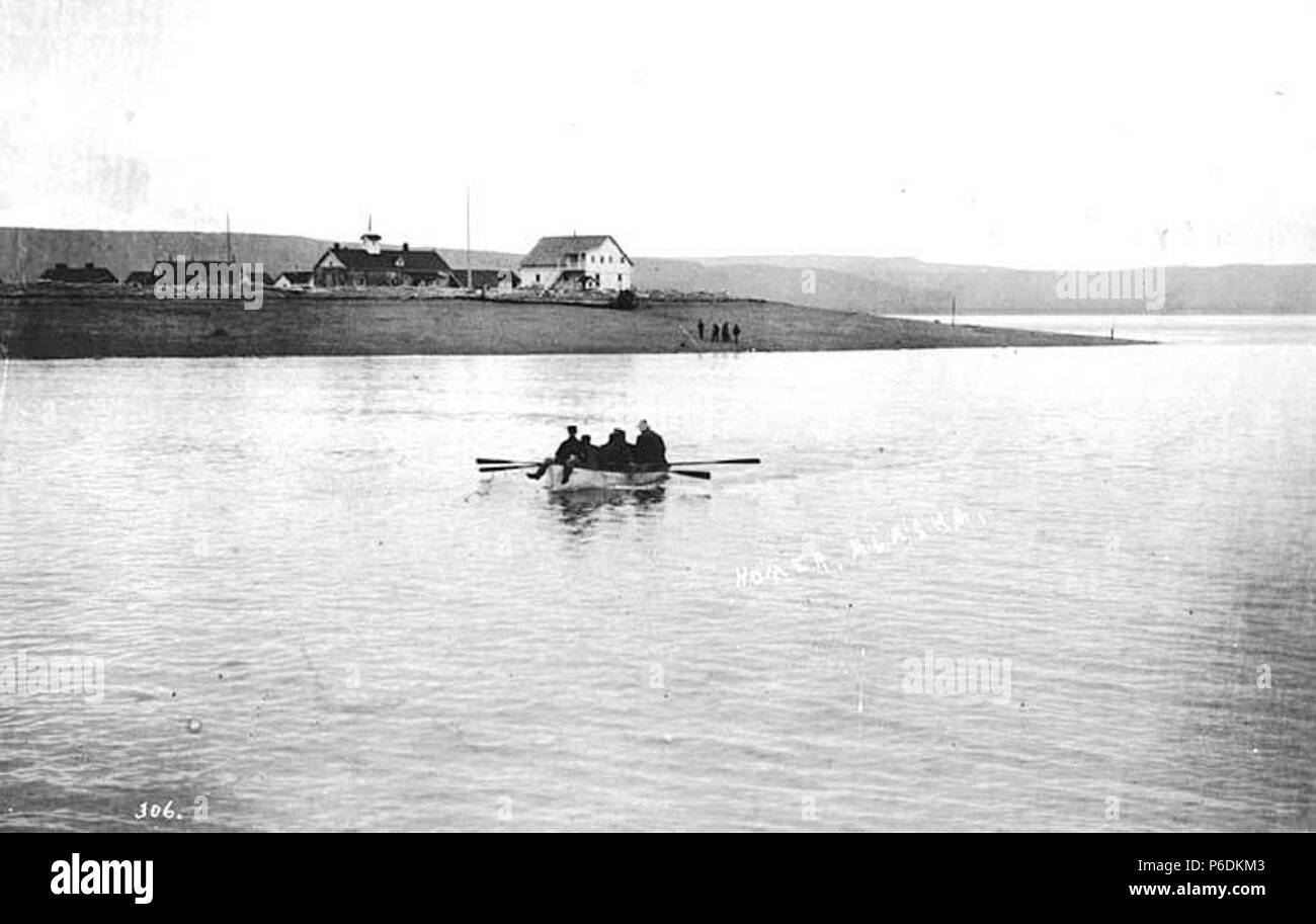 . English: Men in row boat near Homer, ca. 1912 . English: Caption on image: Homer, Alaska PH Coll 247.130 Homer is located on the north shore of Kachemak Bay on the southwestern Kenai Peninsula. The Homer Spit, a 4.5-mile long bar of gravel, extends from the Homer shoreline. It is 227 road miles south of Anchorage, at the southern-most point of the Sterling Highway. The Homer area has been homes to Kenaitze Indians for thousands of years. In 1895 the U.S. Geological Survey arrived to study coal and gold resources. Prospectors bound for Hope and Sunrise disembarked at the Homer Spit. The commu - Stock Image