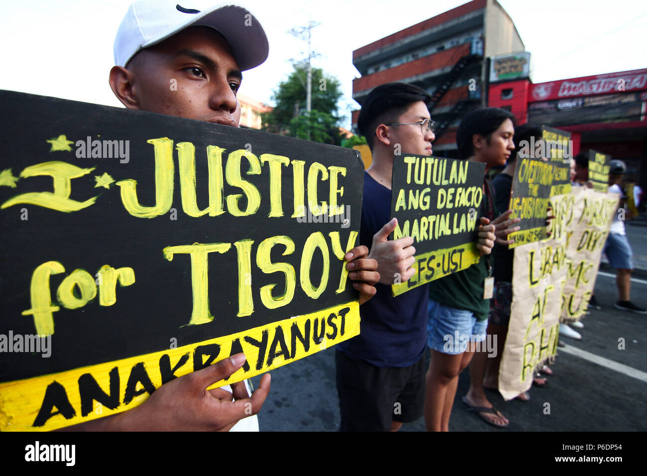 A young man seen holding a placard during the protest. Students from the University of Santo Thomas staged a lightning rally near the presidential palace in Mendiola, Friday afternoon, against the recent deaths of Catholic priests. It was Part of the nationwide Black Friday protests, the students called for justice for Tisoy Argoncillo's death while in police detention for loitering. The group also called for the end of the Martial Law in Mindanao. - Stock Image