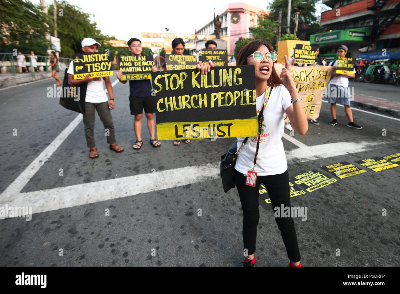 June 29, 2018 - Philippines - Students from the University of Santo Thomas staged a lightning rally near the presidential palace in Mendiola, against the recent deaths of Catholic priests. Part of the nationwide Black Friday protests, the students called for justice for Genesis 'Tisoy' Argoncillo's death while in police detention for loitering. The group also called for the end of the Martial Law in Mindanao. (Credit Image: © J Gerard Seguia via ZUMA Wire) - Stock Image