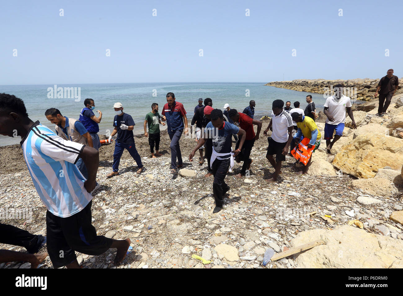 Tripoli  29th June, 2018  Rescued migrants go ashore at the