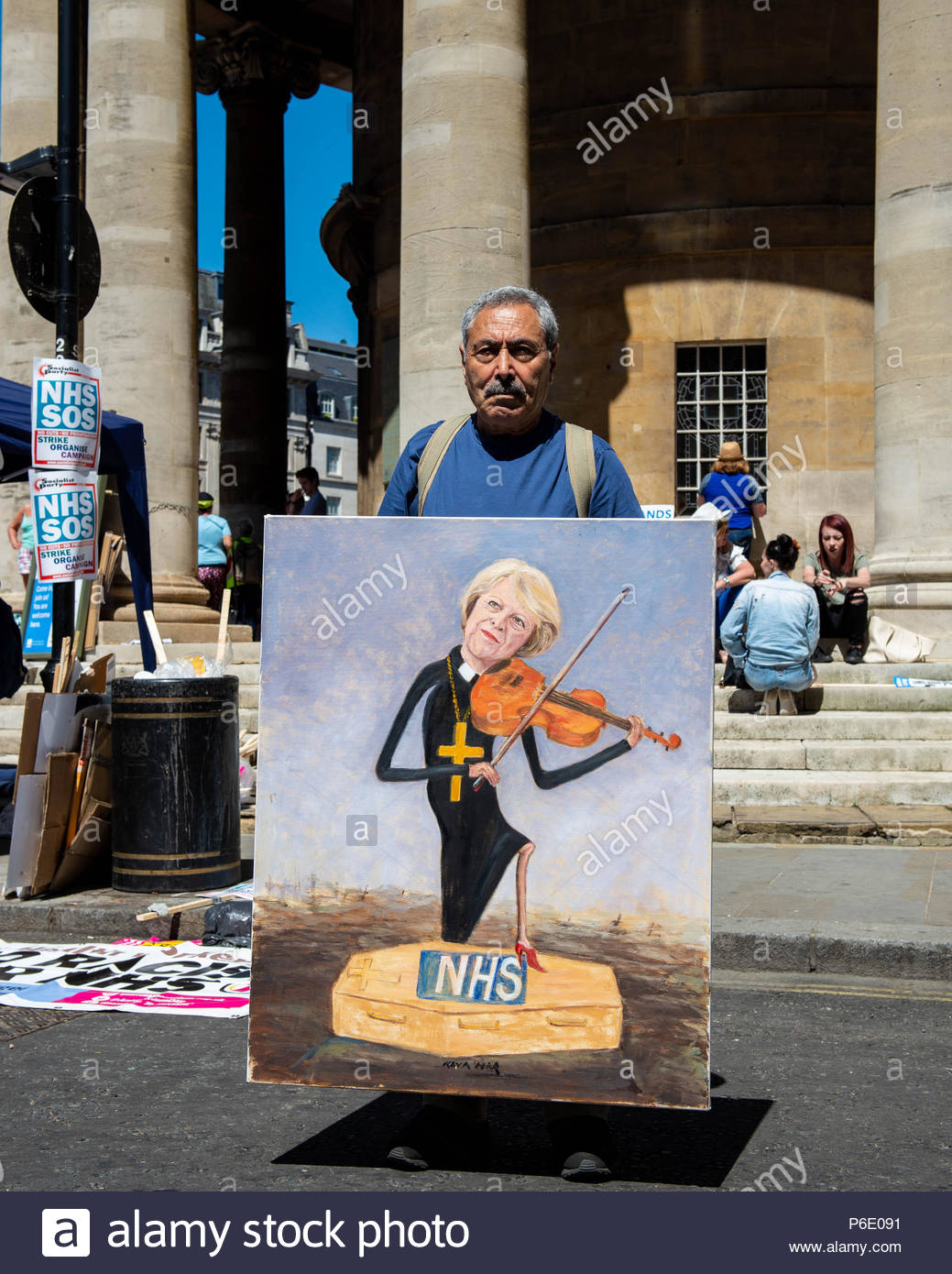 Artist Kaya Mar with his work of art for today's event  London, Great Britain, 30 Jun 2018 A mixture of celebration and demonstration for the thousands of attendees. Celebrating the 70th Birthday of the NHS, and demonstrating to keep it properly funded and free for everyone.  Credit: David Nash/Alamy Live News - Stock Image