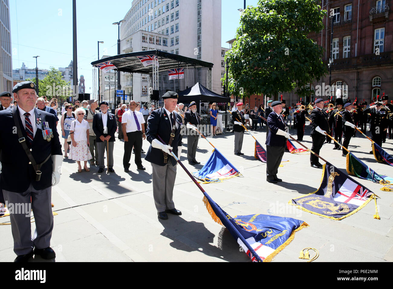 Manchester, UK, 30 June 2018. The lowering of the standards during celebrations of Armed Forces Day where the public are given the opportunity to meet members of the armed forces and talk to them about the work they do, St Peters Square, Manchester, 30th June, 2018 (C)Barbara Cook/Alamy Live News - Stock Image