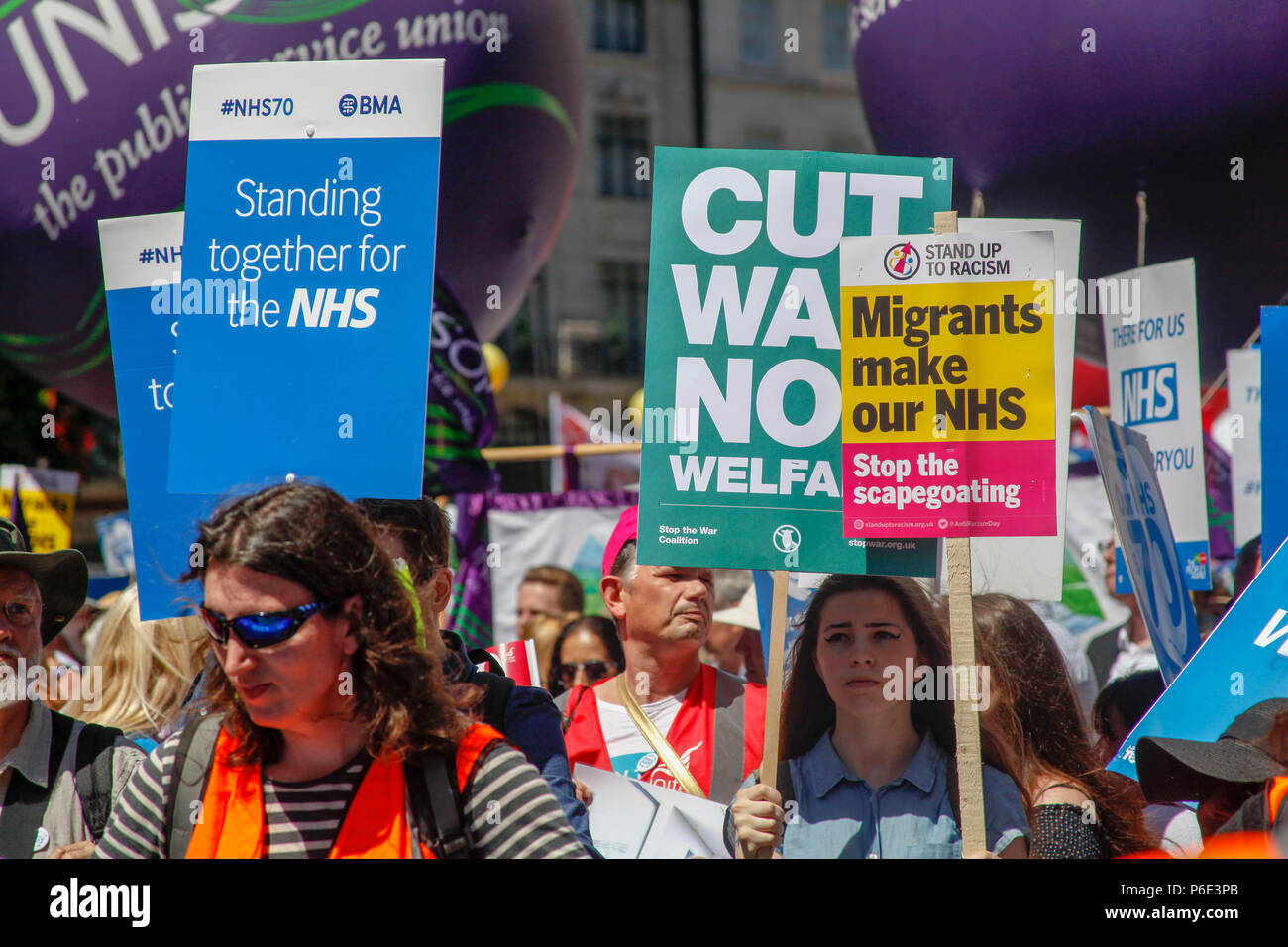 London, UK, 30 June 2018. Demonstrators at the NHS's 70th Birthday March Credit: Alex Cavendish/Alamy Live News - Stock Image