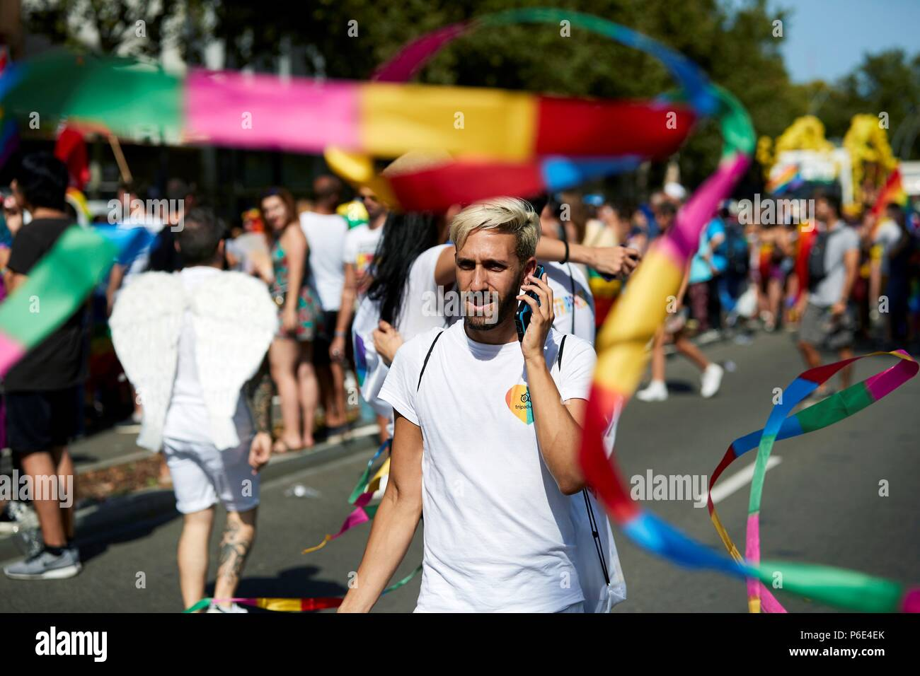 Barcelona, Spain. 30th June, 2018. Thousands attend the Pride 2018 parade in Barcelona, Spain, 30 June 2018. This year Barcelona has dedicated it's Pride Parade to LGTBI refugees. Credit: Alejandro Gardia/EFE/Alamy Live News - Stock Image