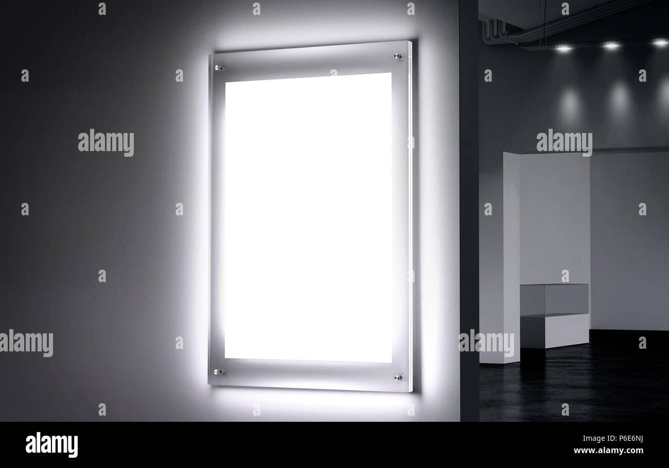 Blank white illuminated poster mock up in dark hall, 3d rendering. Clear glowing affiche design mockup mounted on gallery wall. Led acrylic billboard with empty placard in cinema room. Light box sign Stock Photo