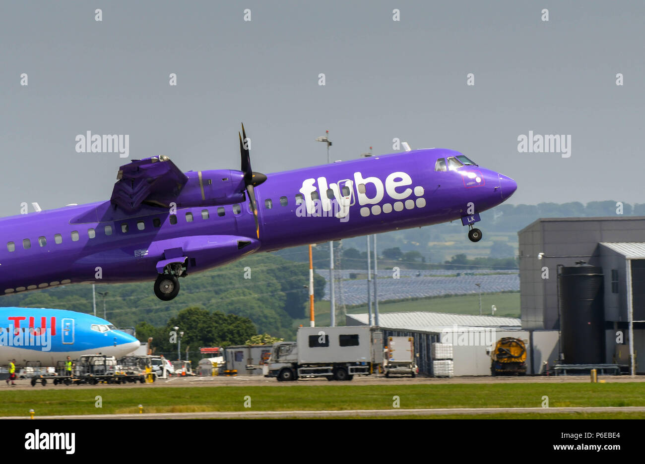 ATR 72 turboprop short haul airliner operated by Flybe taking off at Cardiff Wales Airport - Stock Image
