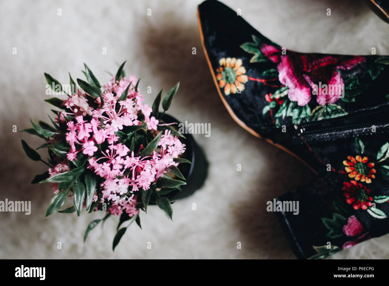 Fashion Floral Boots with Floral decor - Stock Image