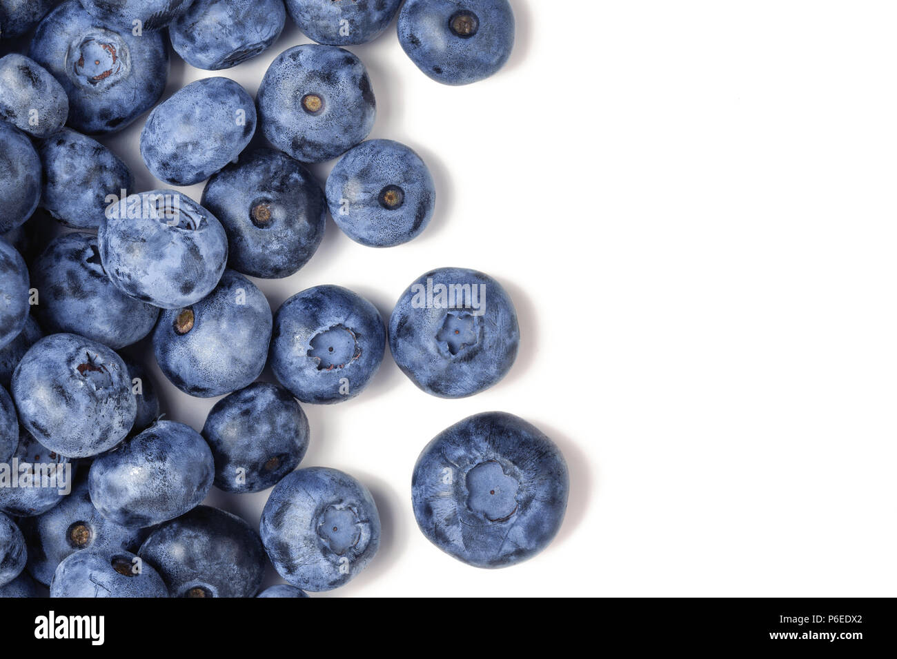 Top view of fresh ripe blueberries isolated on white. Close-up organic juicy freshly picked bilberries. Copyspace. Flat lay - Stock Image