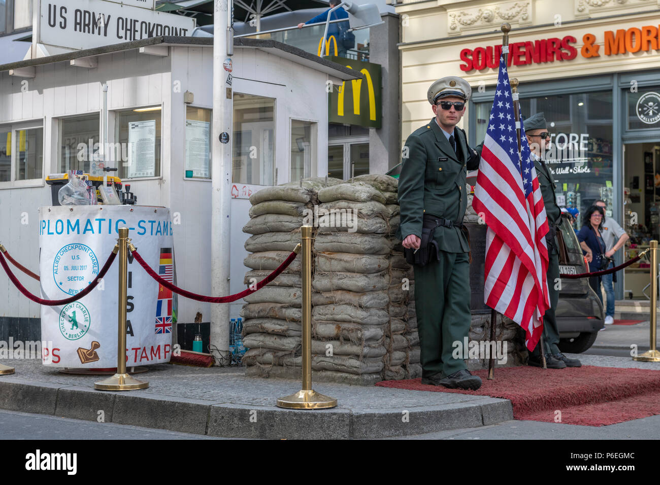 During the 'Cold War' Checkpoint Charlie used to be one of the most famous border crossings in the world. Nowadays it is a major tourist attraction in - Stock Image