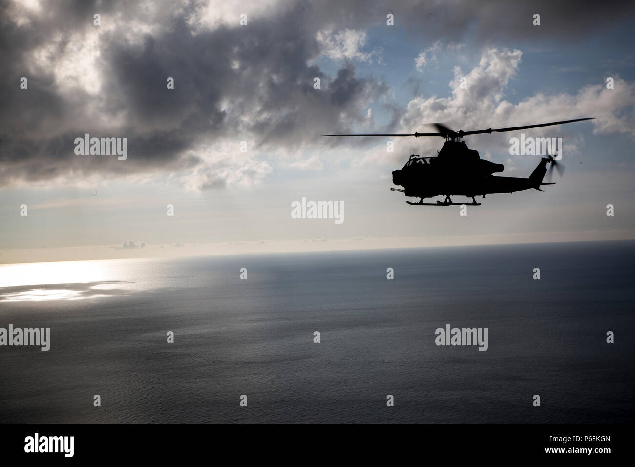 A U.S. Marine Corps AH-1Z Viper helicopter assigned to Marine Light Attack Helicopter Squadron 469, Marine Aircraft Group 39, 3rd Marine Aircraft Wing, under the unit deployment program with MAG-36, 1st MAW flies over Okinawa, Japan, after conducting a live fire event, June 27, 2018. Conducting live fire training is crucial to maintain efficiency and strength. (U.S. Marine Corps photo by Pfc. Ryan Persinger) Stock Photo