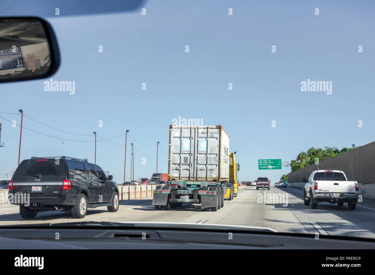 Miami Florida Interstate Highway I-95 I95 traffic truck lorry moving traffic roadway - Stock Image