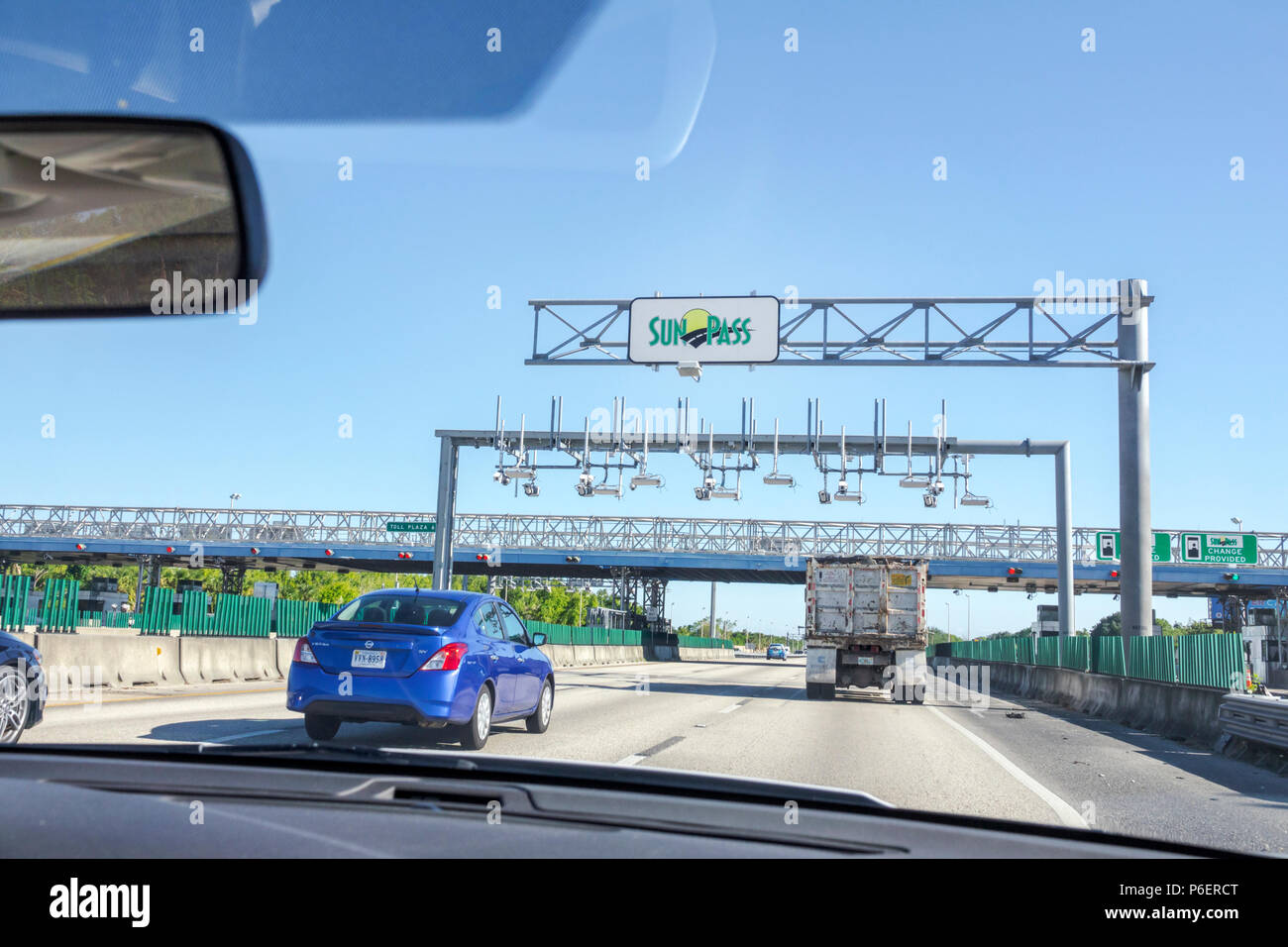 Florida Fort Ft. Lauderdale Florida Turnpike toll road SunPass prepaid electronic toll collection system traffic highway car truck moving vehicles - Stock Image