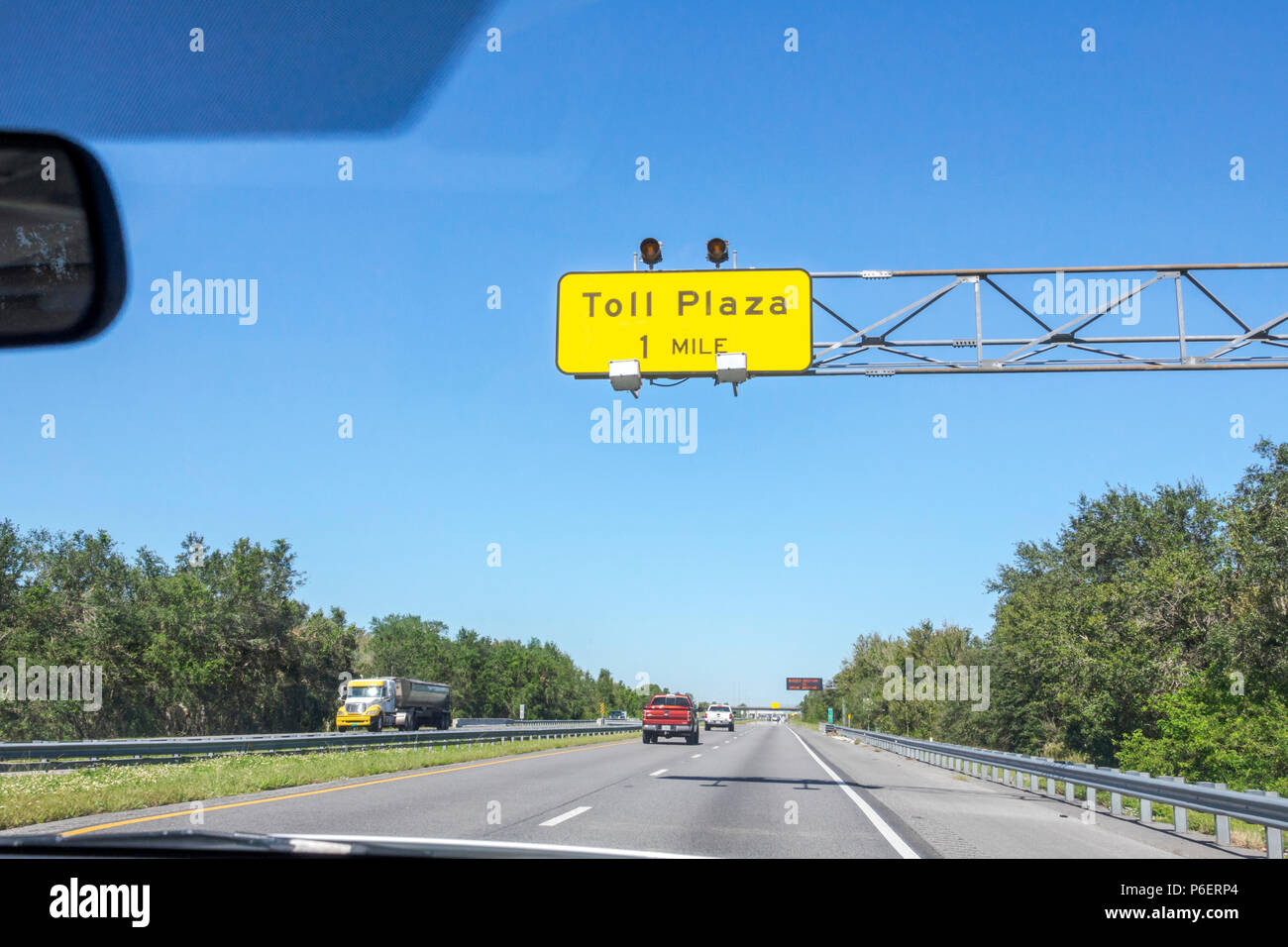 Fort Ft. Pierce Florida Florida Turnpike toll road plaza distance information sign roadway highway traffic - Stock Image