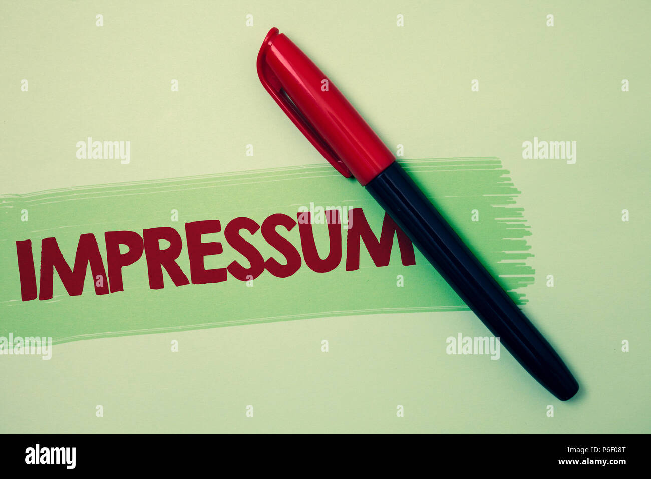 Conceptual hand writing showing Impressum. Business photo showcasing Impressed Engraved Imprint German statement ownership authorship Ideas messages r - Stock Image