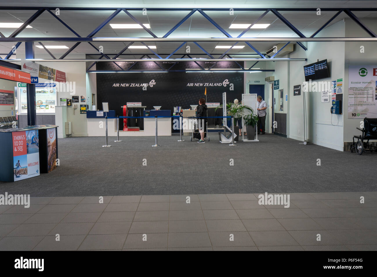 Tauranga New Zealand - January 16, 2018: Inside tauranga airport showing checkin counters with few people - Stock Image