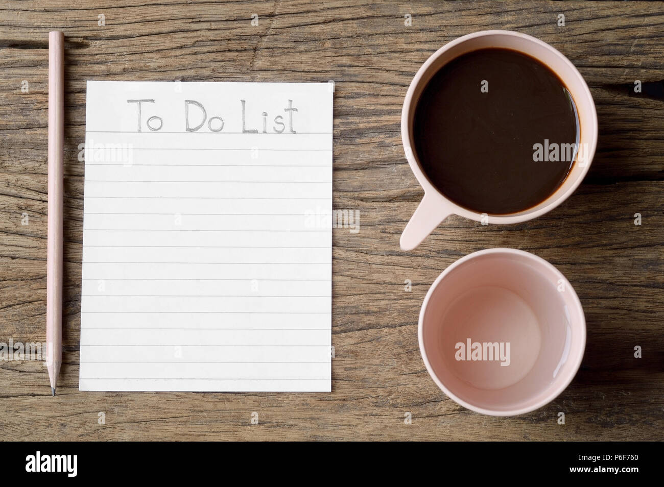 to do list word on wooden table with coffee cup drinking water and