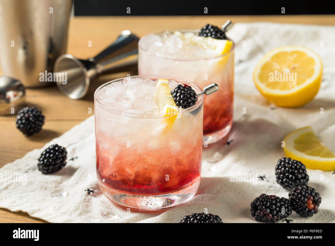 Alcoholic Blackberry Gin Bramble Cocktail with Lemon - Stock Image