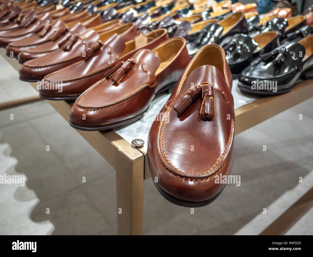 c7437288093 Men's leather shoes loafers displayed in shopping mall. Debenhams ...
