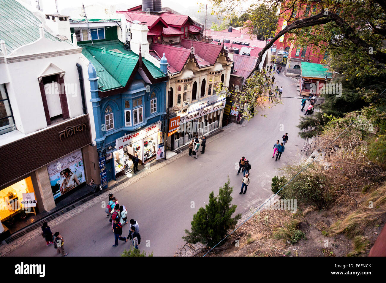 Shimla, India - 25th Apr 2018: Branded showrooms with lights on the mall road in Shimla housed in british styled buildings. Shows the huge penetration - Stock Image