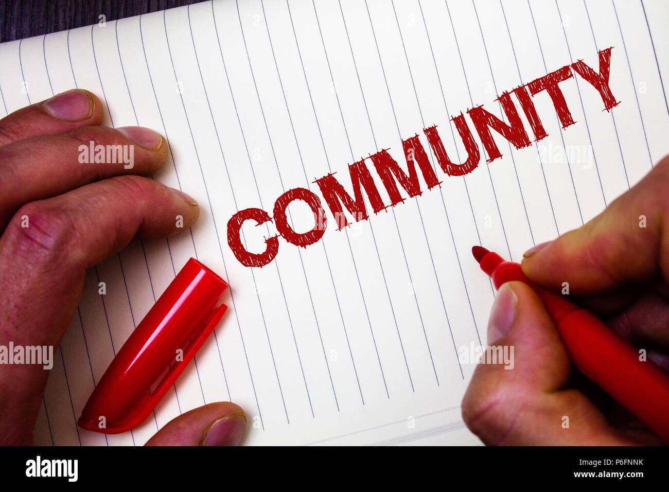 Conceptual hand writing showing Community. Business photo showcasing Neighborhood Association State Affiliation Alliance Unity Group Man hold holding  - Stock Image