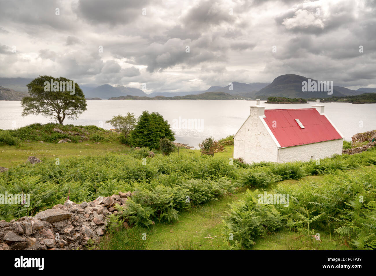 Red Roof Cottage at shieldaig, Scotland. Part of the North coast 500 route. - Stock Image