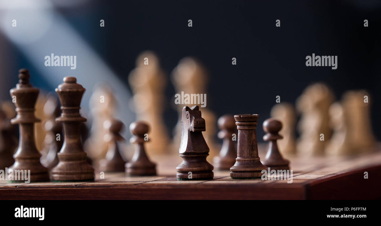 Wooden chess pieces on a chessboards - Stock Image