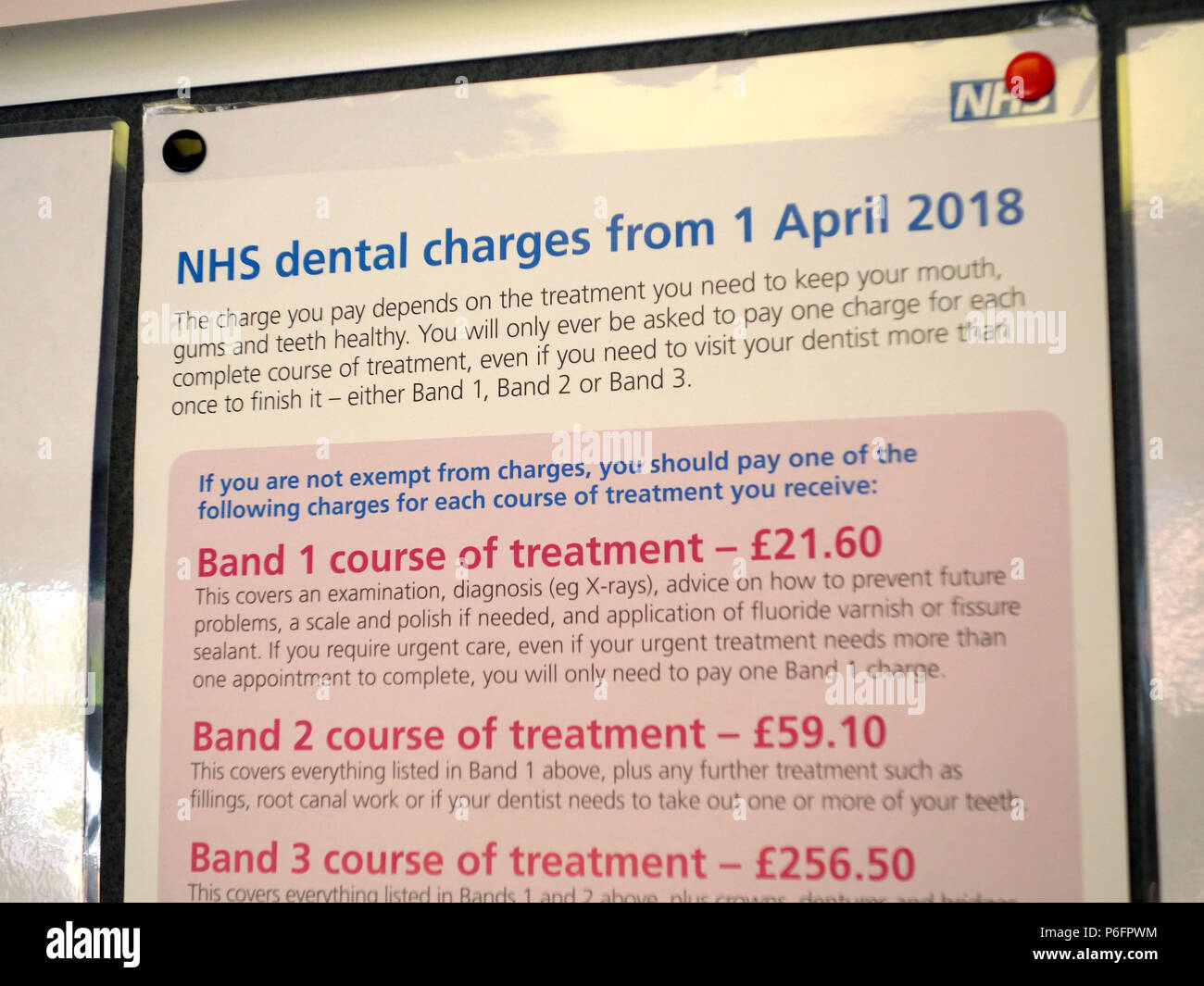 Help and advice notices for patients at a local Dental Surgery, includes posters re NHS dental charges from April 2018 - Stock Image