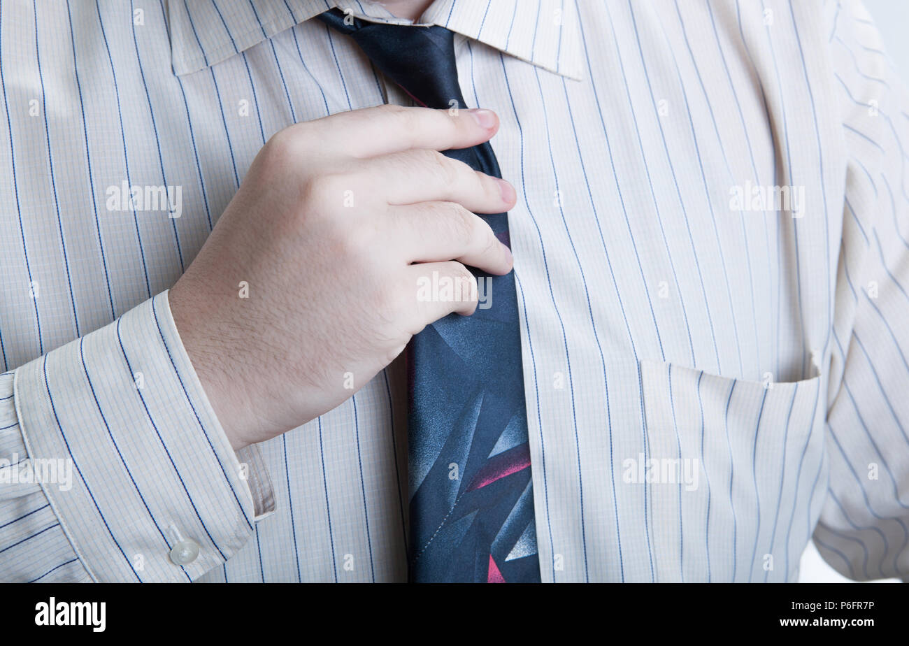 hand business man straightens his tie closeup - Stock Image