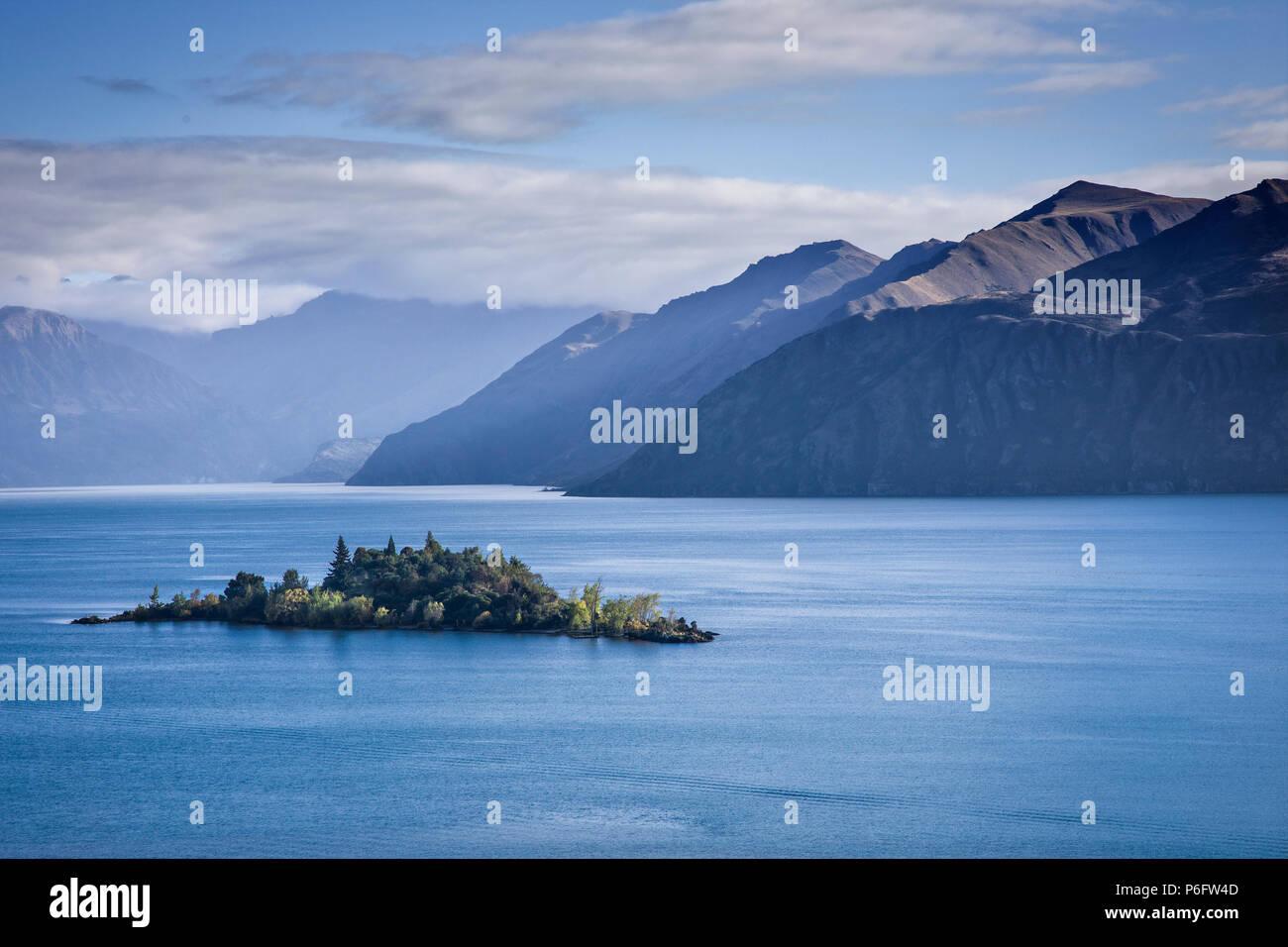 A small island in Lake Wanaka, South Island, New Zealand. - Stock Image