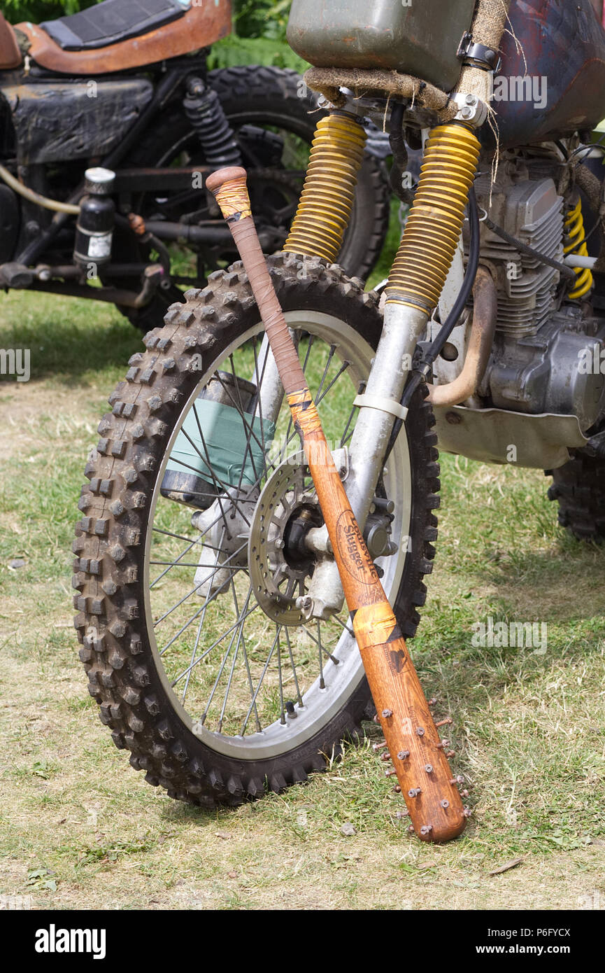 Off road motorcycle with a baseball bat with screws in called slugger Stock Photo