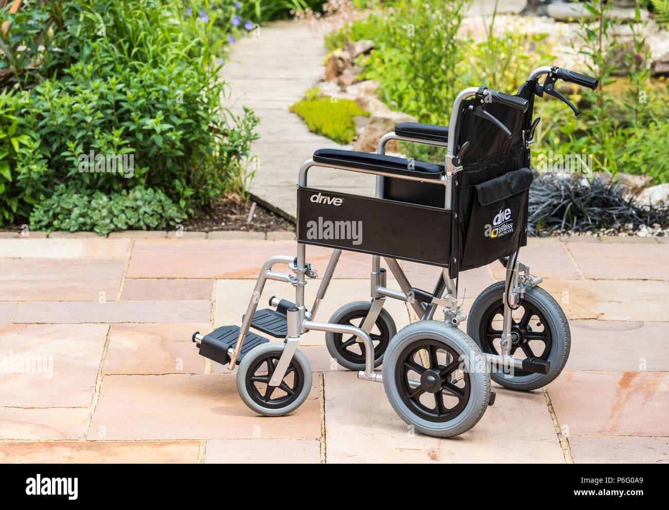 Disability, mobility, invalid wheelchair. - Stock Image