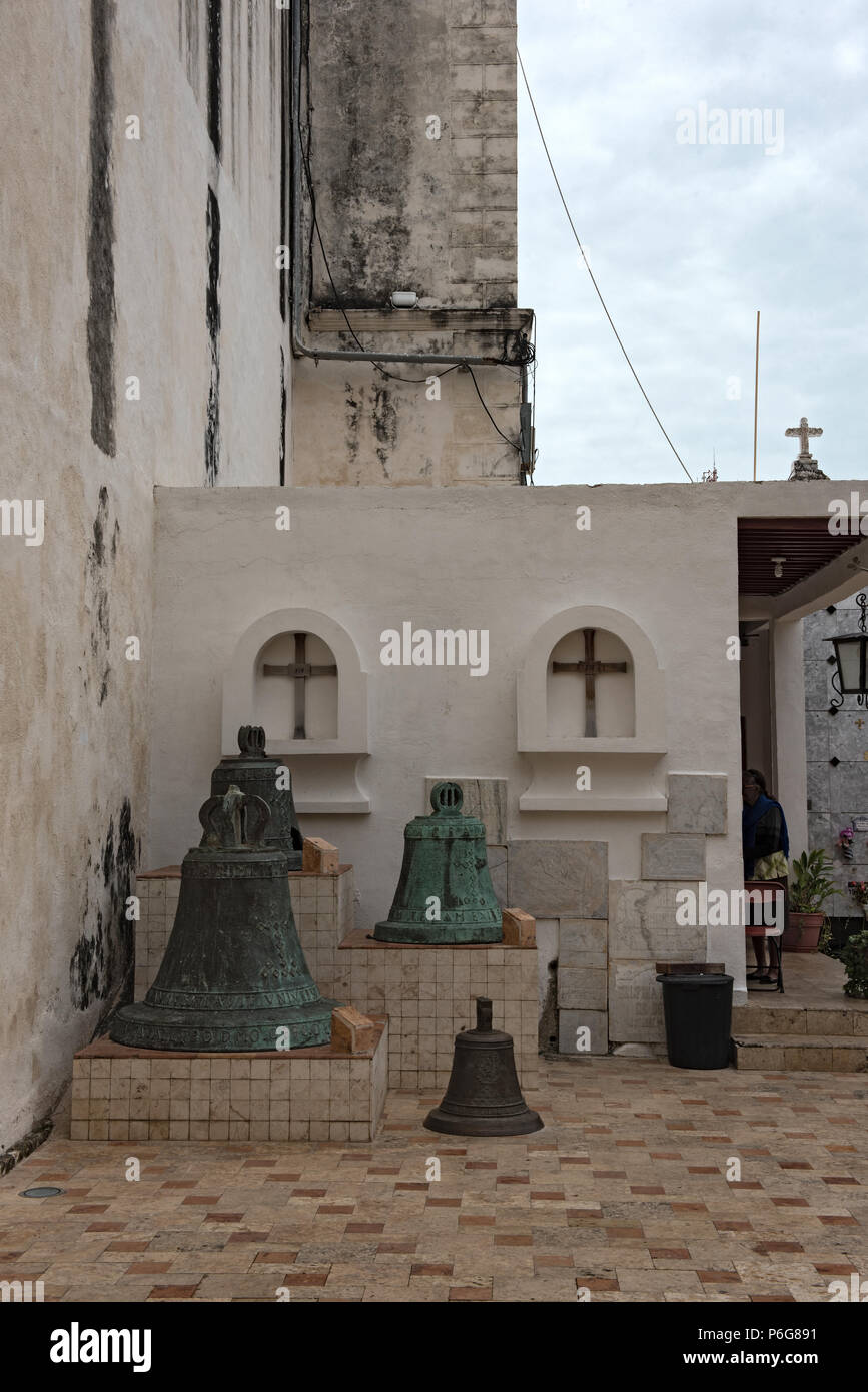 bells in the garden of the Cathedral san francisco de campeche with museum, mexico - Stock Image