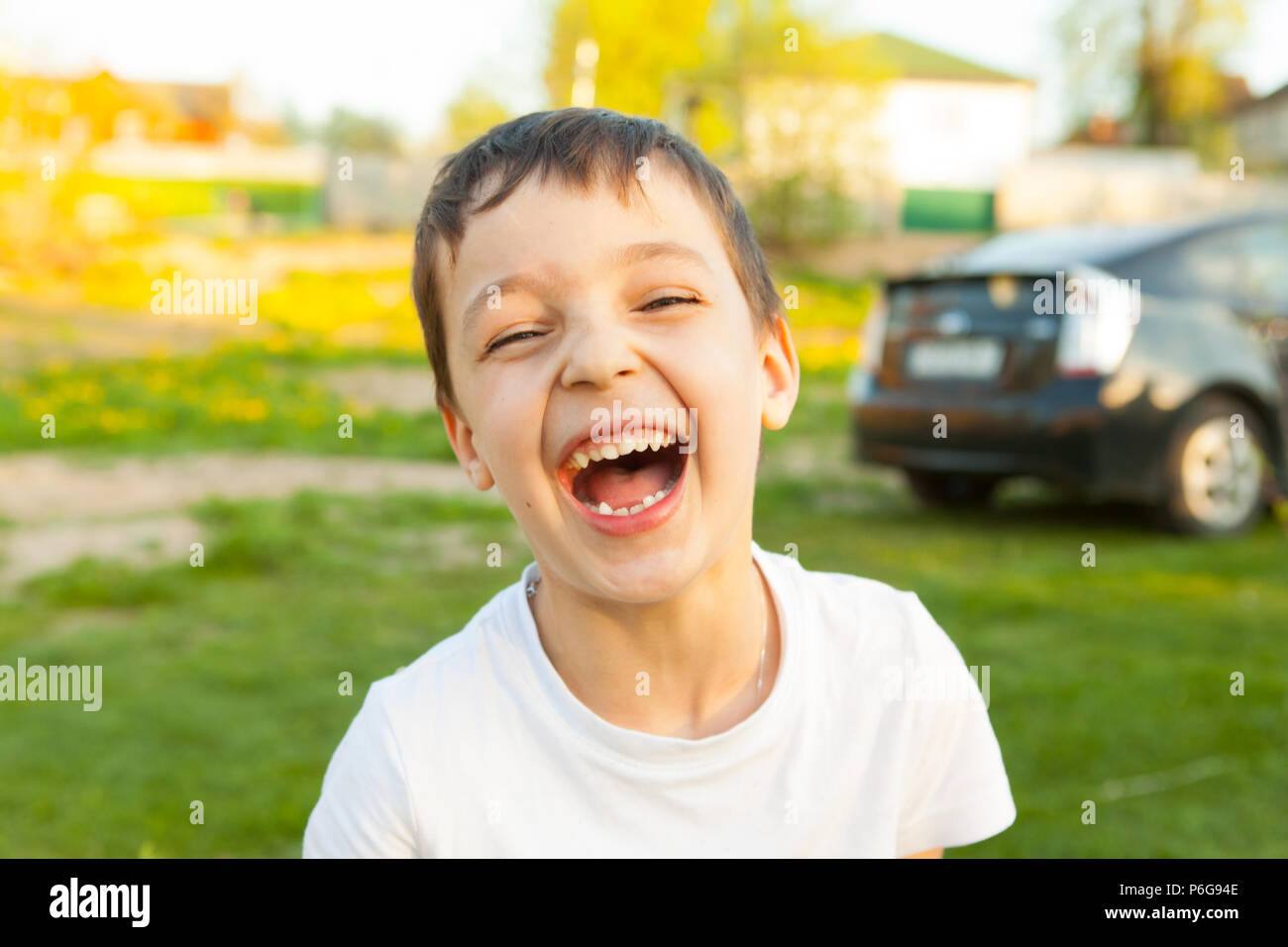boy is laughing loudly in cafe - Stock Image