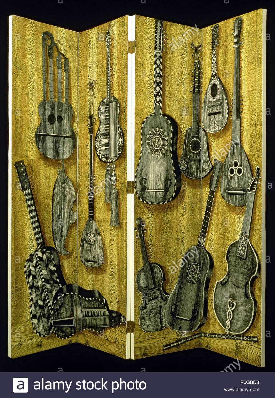 Screen in four panel decorated with musical instruments guitar, lute, violi,  1920's. Private Collection. - Stock Image