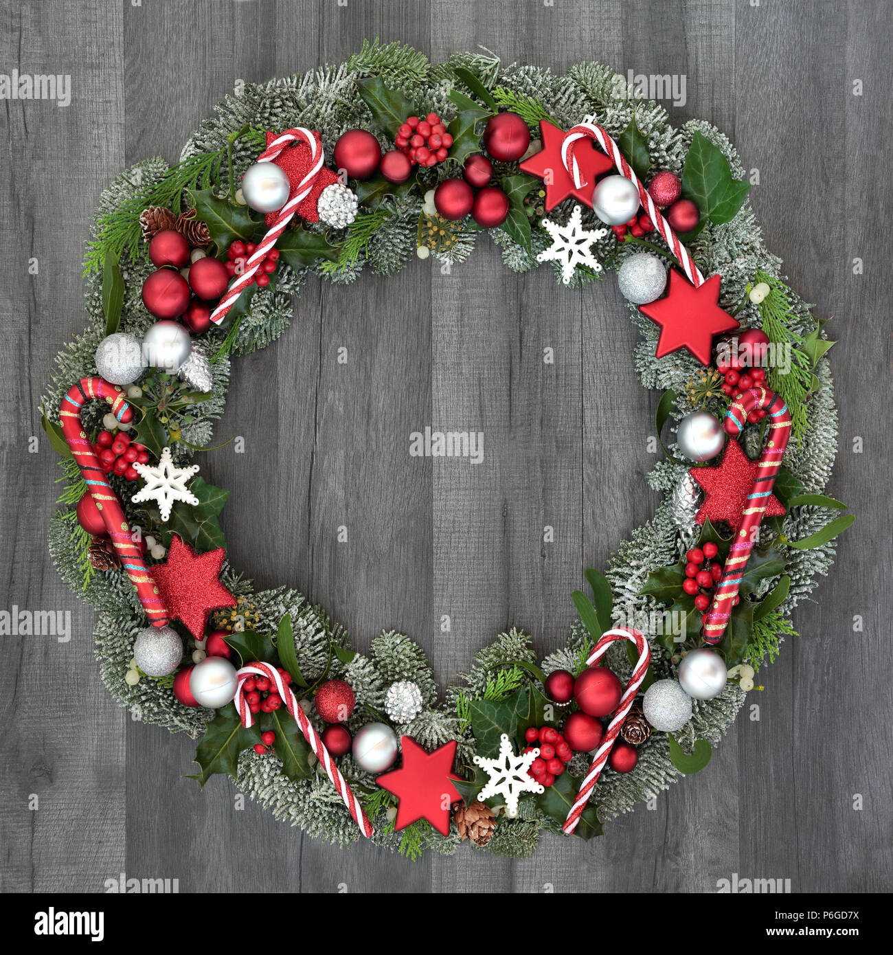 Christmas And Winter Wreath With Candy Canes And Bauble Decorations Holly Mistletoe Ivy And Spruce Fir On Rustic Grey Wood Background Stock Photo Alamy
