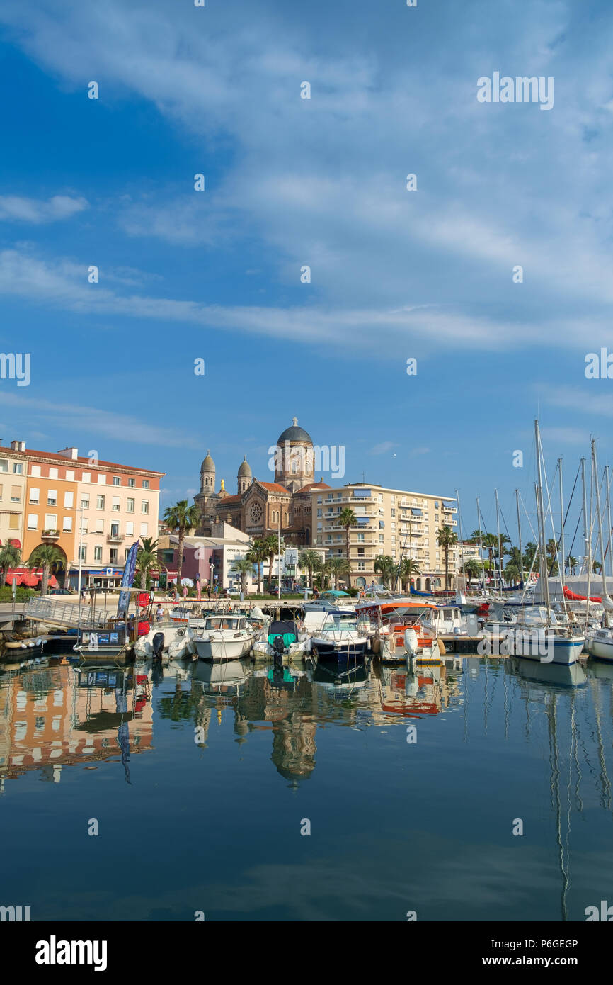 The cathedral, seafront buidings and marina, Saint Raphael, France. - Stock Image