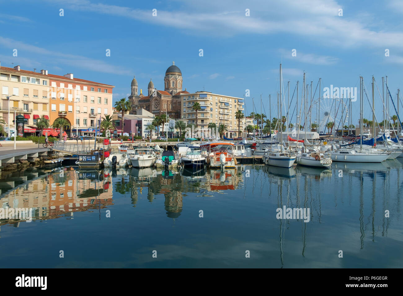The cathedral, seafront buidings and boats, Saint Raphael, France. - Stock Image