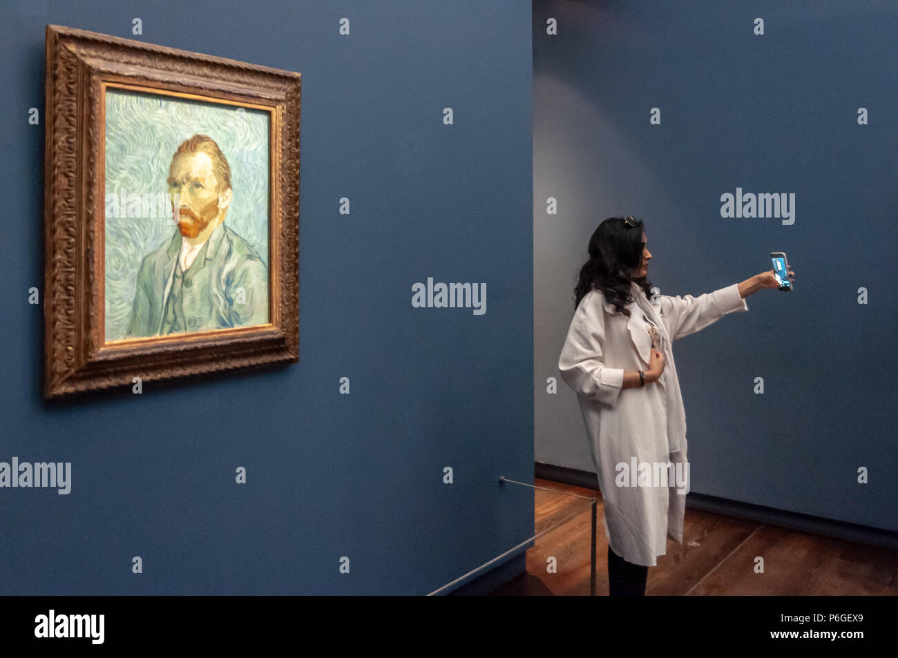 People consuming art at Musée d'Orsay - Stock Image