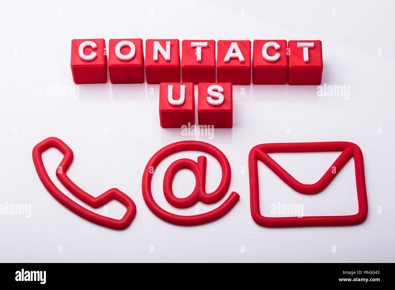 Red Cubes With Contact Us Text And Icons Showing Various Communication Options Stock Photo