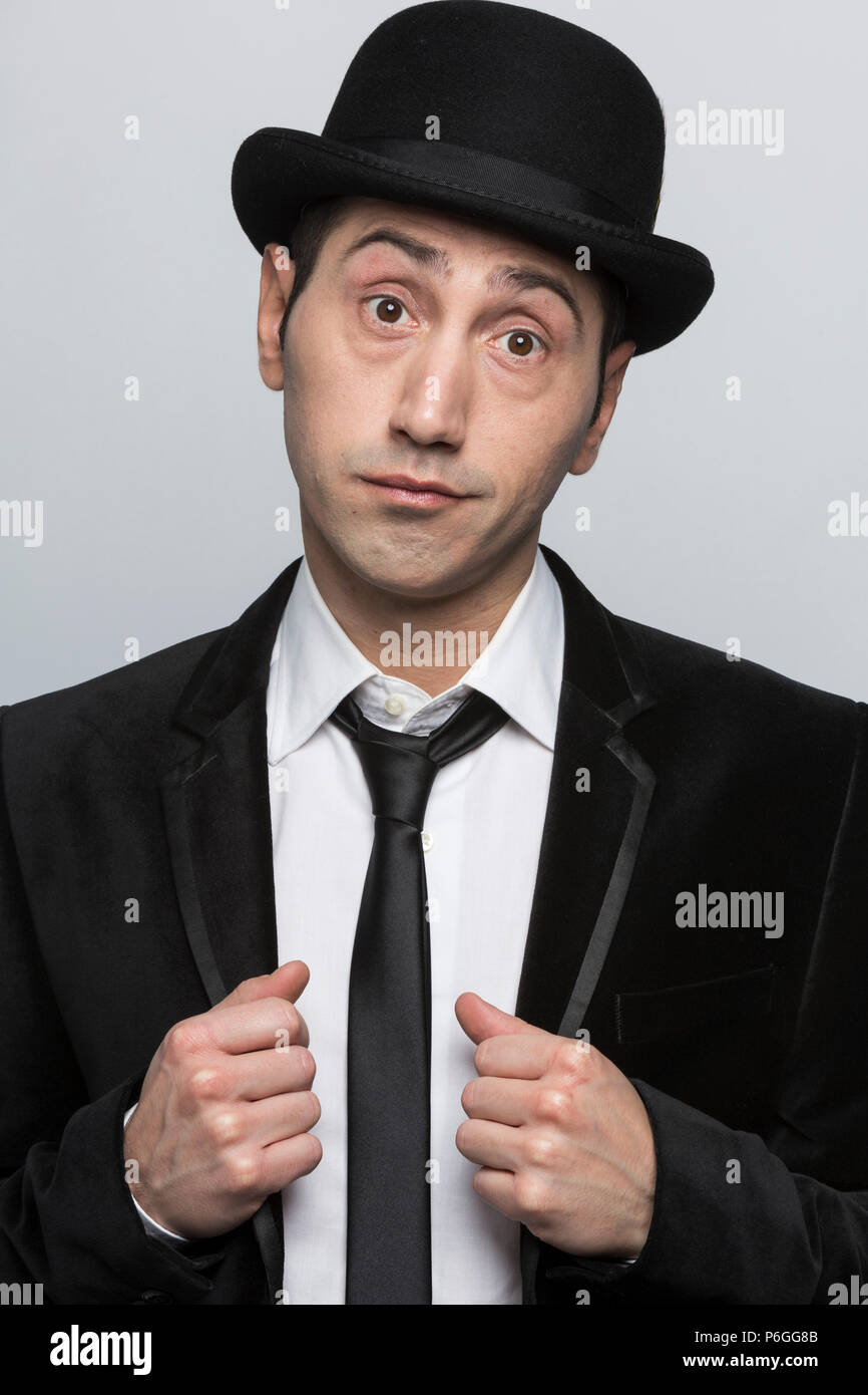 865fe5664a95e3 Portrait of man wearing a black bowler hat and a black suit - Stock Image