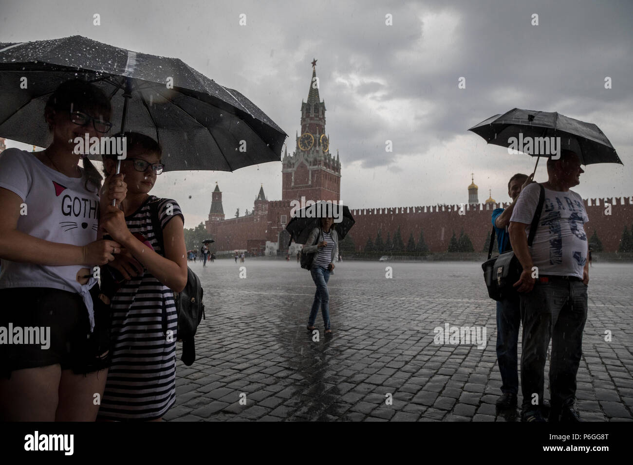 Rainy weather in Moscow. People with umbrella on Red square in central Moscow, Russia - Stock Image