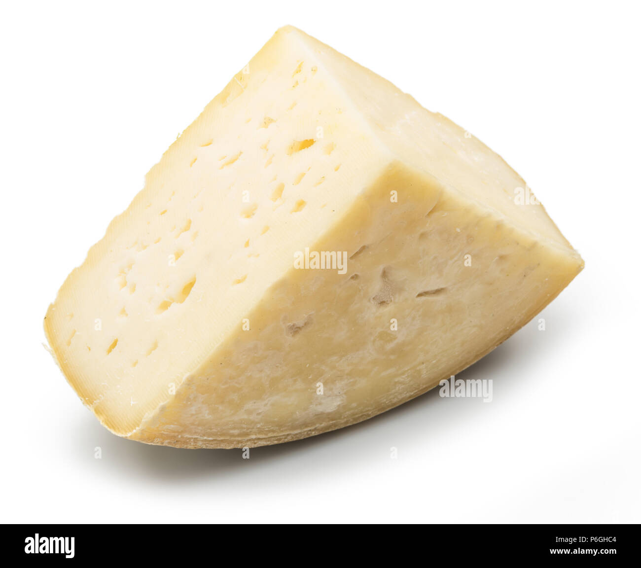 Piece of homemade cheese on the white background. Stock Photo