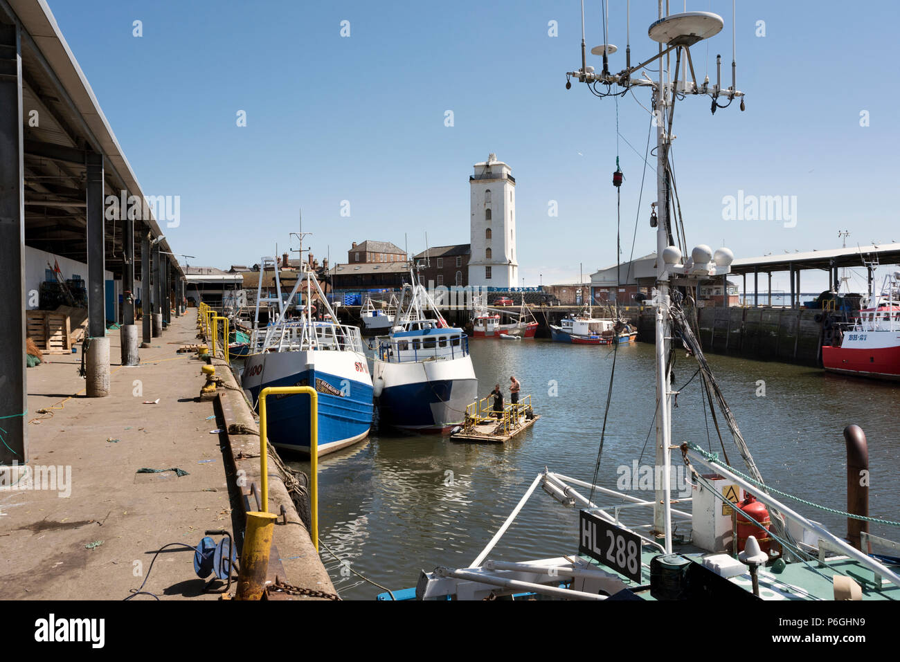 The Fishing Quay at North Shields, Tyneside, UK, with the Low Light in the background - Stock Image